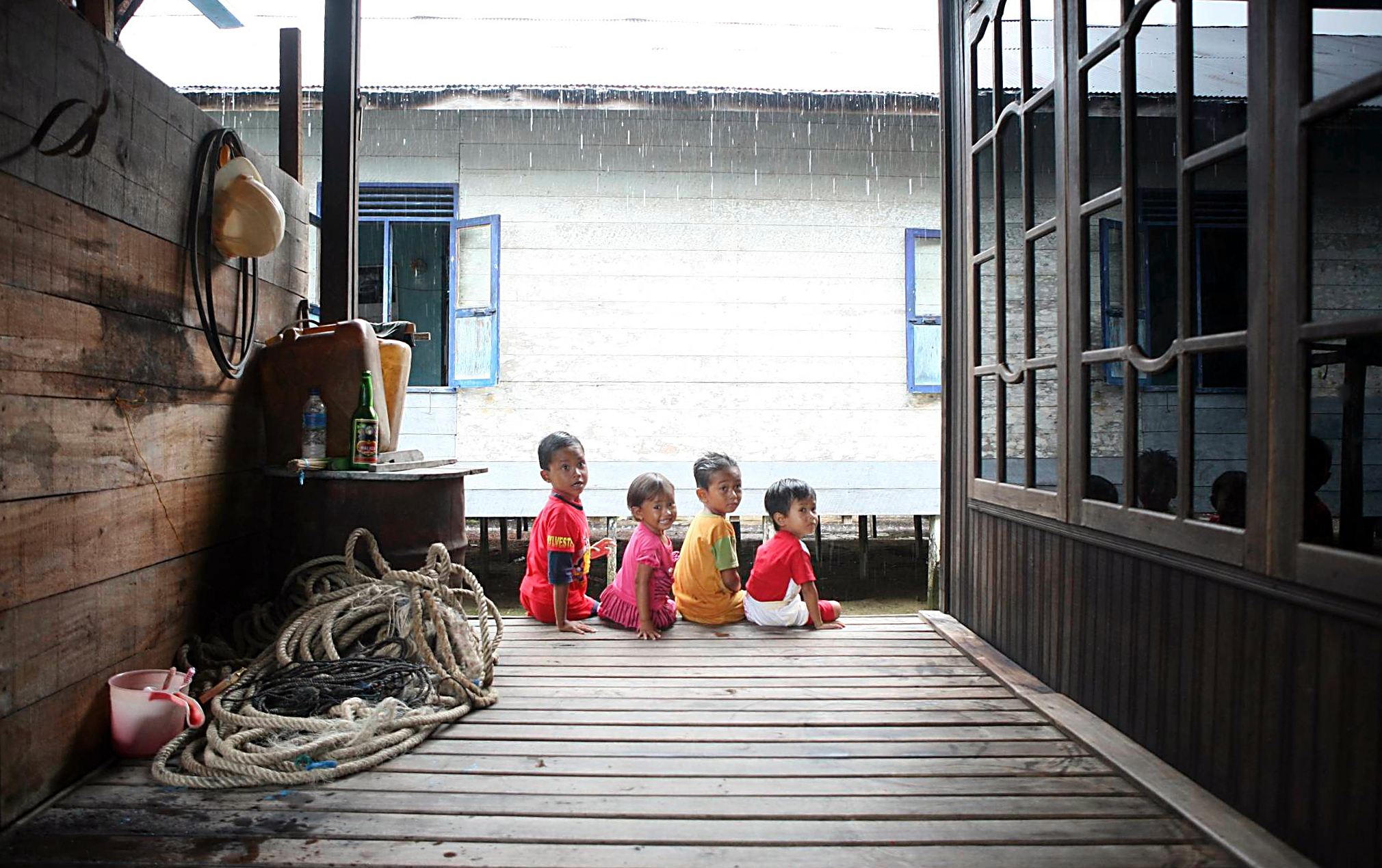 Group of young children sitting and looking out